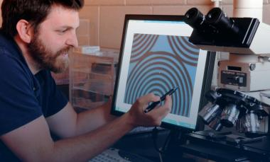 researcher shows an optical microscope image